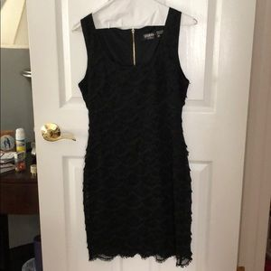 Black Guess LBD with shell pattern overlay